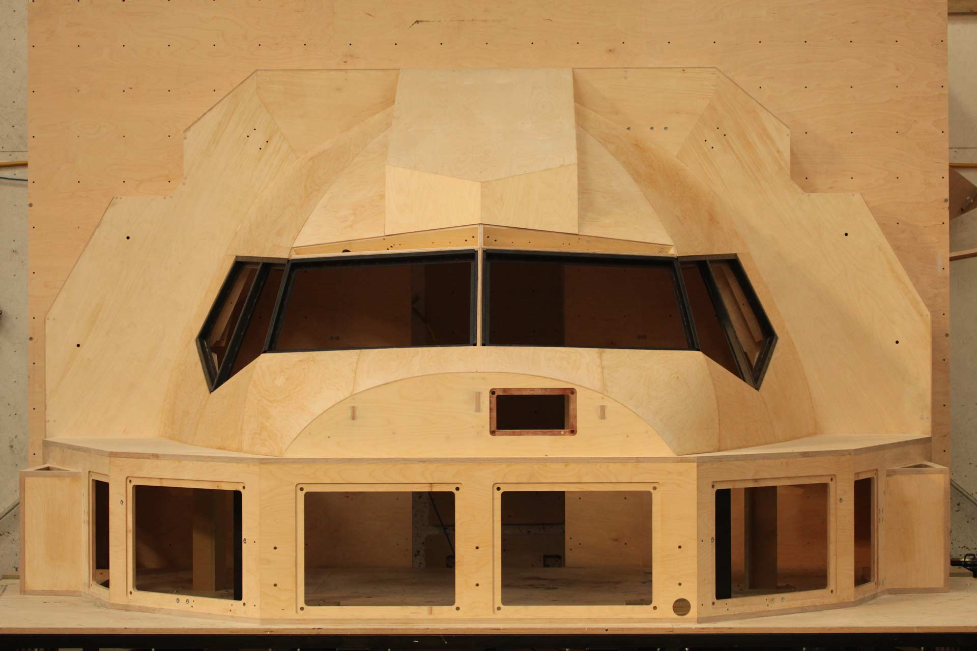 A full scale flight simulator cockpit, precision machined from plywood